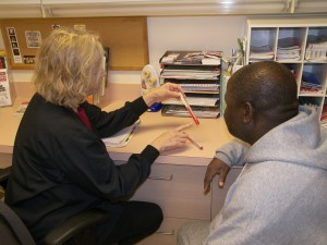 WGMC nurse Deb Cowger talks to a patient with diabetes about the importance of monitoring blood sugar levels.