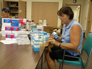 Volunteers Rose and Chuck Gilbert sort donated sample medications. When the Clinic cannot use these medications, they are shared with medical missions both in the U.S.A. and abroad.